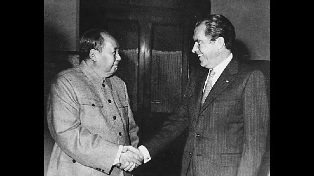 Chairman Mao Zedong shakes hands with U.S. President Richard Nixon in Beijing, Feb. 21, 1972. [Photo: CGTN/Nixon Presidential Library]