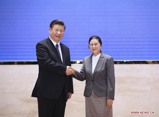 Chinese President Xi Jinping (L), also general secretary of the Communist Party of China Central Committee, shakes hands with President of the Lao National Assembly Pany Yathotu during their meeting in Vientiane, Laos, Nov. 14, 2017. [Photo: Xinhua]