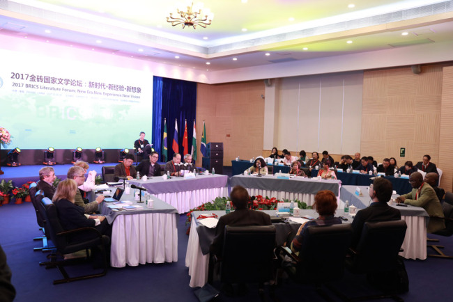 Writers and literary critics from Brazil, Russia, India, China, and South Africa discuss the future facing BRICS literature in the city of Zhuhai of China's Guangdong Province on December 15, 2017. [Photo courtesy of Beijing Normal University]
