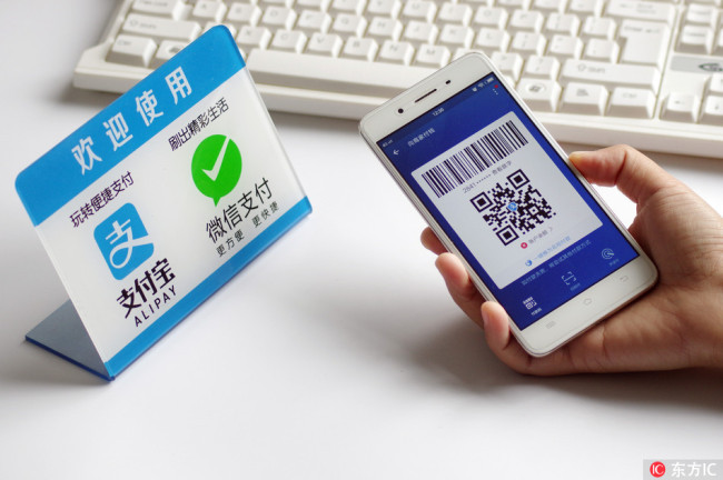 The photo shows logos of Alipay and WeChat Pay. [File photo: IC]