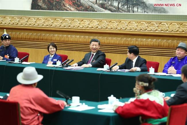 Chinese President Xi Jinping, also general secretary of the Communist Party of China (CPC) Central Committee and chairman of the Central Military Commission, joins a panel discussion with the deputies from Inner Mongolia Autonomous Region at the first session of the 13th National People's Congress in Beijing, capital of China, March 5, 2018. [Photo: Xinhua/Xie Huanchi]