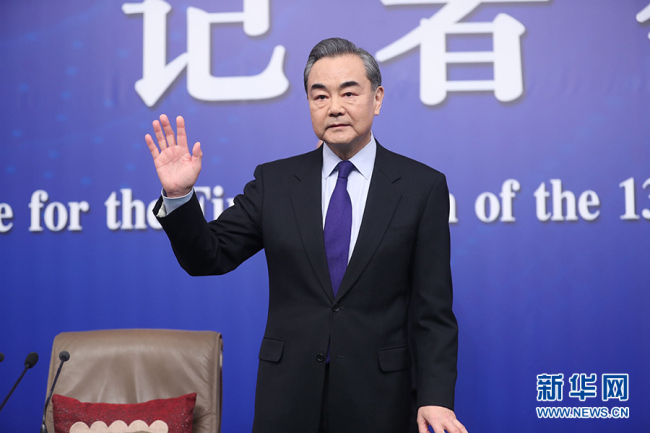 Chinese Foreign Minister Wang Yi meets the press in Beijing, on March 8, 2018. [Photo: Xinhua]