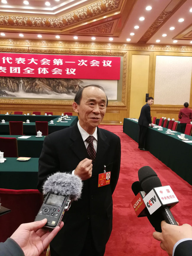 Ma Shanxi, a deputy from the municipality of Chongqing for the 13th National People's Congress (NPC) is interviewed by journalists on March 10, 2018. [Photo: China Plus]