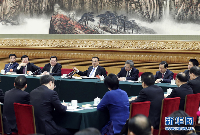 Senior Chinese leaders joined deputies in panel discussions on Monday at the first session of the 13th National People's Congress (NPC). [Photo: Xinhua]