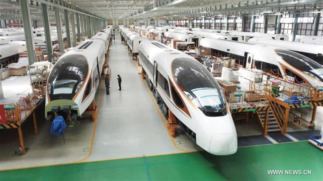 File photo taken on Sept. 14, 2017 shows Fuxing bullet trains at the assembly workshop at CRRC Changchun Railway Vehicles Co. Ltd. in Changchun, northeast China's Jilin Province.[Photo: Xinhua]