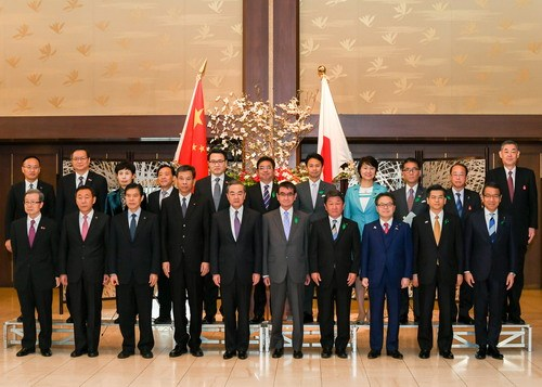 Chinese State Councilor and Foreign Minister Wang Yi, Japanese Foreign Minister Taro Kono, as well as senior officials of foreign affairs, economic and finance ministries of both countries pose a group photo in Tokyo on April 16, 2018. [Photo: fmprc.gov.cn]