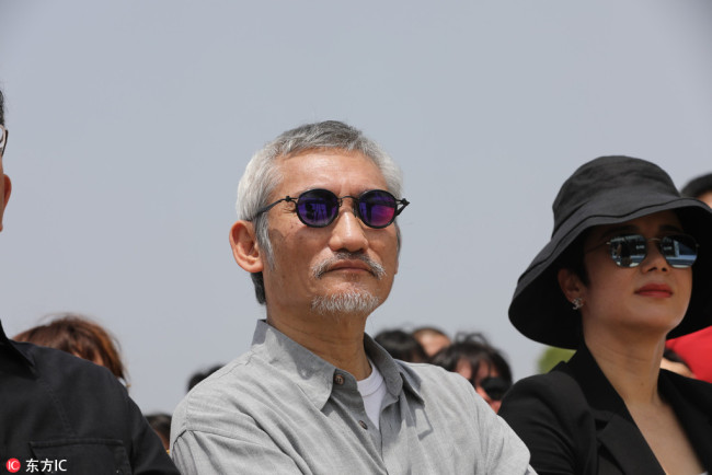 Chinese director Tsui Hark attends the groundbreaking ceremony for restoring historic buildings in Bengbu, East China's Anhui province, May 13, 2018. [Photo/IC]