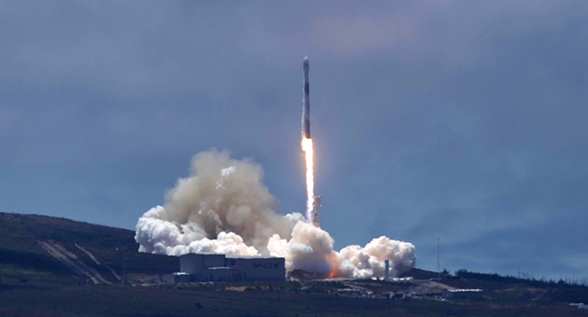 A SpaceX Falcon 9 rocket carrying two U.S.-German science satellites and five commercial communications satellites blasts off from Vandenberg Air Force base on the central California coast Tuesday afternoon, May 22, 2018. The science payload from NASA and the German Centre for Geosciences includes two identical satellites for the Gravity Recovery and Climate Experiment. [Photo: AP/Matt Hartman]