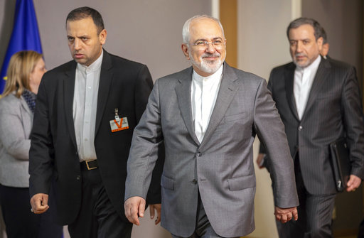 Iranian Foreign Minister Javad Zarif, center, leaves after a meeting with European Union foreign policy chief Federica Mogherini at the Europa building in Brussels on Tuesday, May 15, 2018. [Photo: AP]