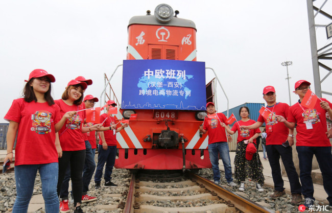 The first cross-border e-commerce freight train launched by JD Logistics of Chinese online retailer JD.com linking Xi'an with Hamburg of Germany is pictured after arriving at a terminal station in Xi'an city, northwest China's Shaanxi province, May 21, 2018.[Photo: dfic.cn]