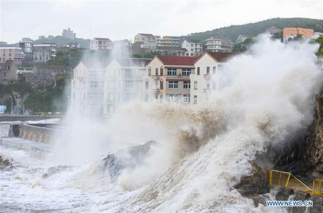 Huge waves beat against the sea shore in Shitang Township of Wenling City, east China's Zhejiang Province, July 10, 2018, as Typhoon Maria, the eighth typhoon this year, approaches the coast.