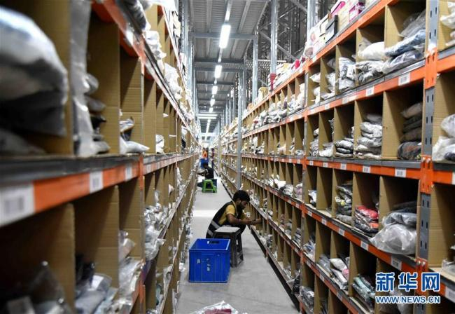Workers sort out packages at a JollyChic warehouse in Riyadh, capital of Saudi Arabia on June 25, 2018. [Photo: Xinhua]