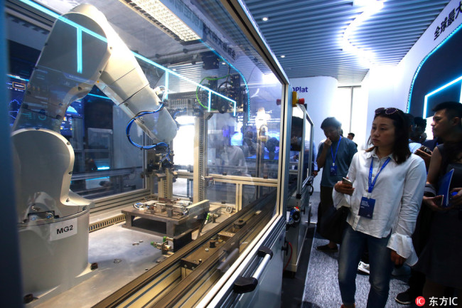 Visitors have a tour at the Science and Tech Corridor in Songjiang District, Shanghai, May 28, 2018. [Photo: IC]