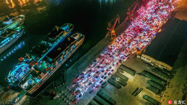 Aerial photo taken on February 21, 2018 shows the traffic jam at Haikou Xiuying Port in south China's Hainan Province after ferry services were disrupted by heavy fog. [Photo: IC]