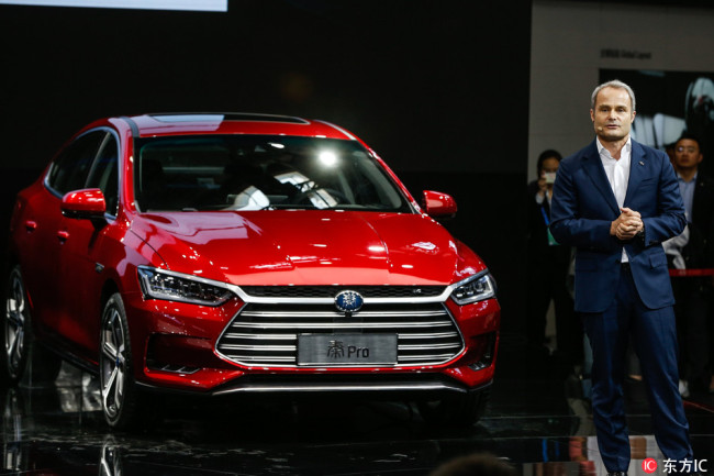 Wolfgang Egger, design director of Chinese automaker BYD, delivers a speech as he presents the Qin Pro self-driving car during the Auto China motor show in Beijing on April 25, 2018. [Photo:IC]