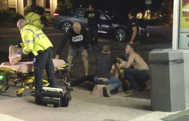 A victim is treated near the scene of a shooting, Wednesday evening, Nov. 7, 2018, in Thousand Oaks, Calif. [Photo: AP]
