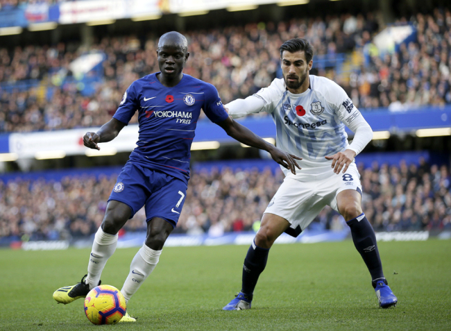 Chelsea's N'Golo Kante, left, duels for the ball with Everton's Andre Gomes during the English Premier League soccer match between Chelsea and Everton at Stamford Bridge stadium in London, Sunday, Nov. 11, 2018. [Photo: AP/Tim Ireland]