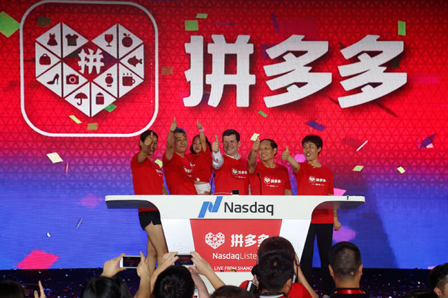 Company executives of Pinduoduo celebrate as the company gets listed on the Nasdaq on July 26. [from China Daily]
