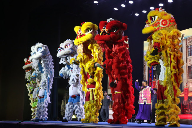 """Dragon dances are performed during a stage show, the """"Legend of Kungfu,"""" in Mauritius, November 30, 2018. [Photo: China Plus/Gao Junya]"""
