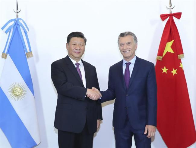 Chinese President Xi Jinping (L) meets with his Argentine counterpart Mauricio Macri in Buenos Aires, capital of Argentina, on Sunday, December 2, 2018. [Photo: Xinhua]
