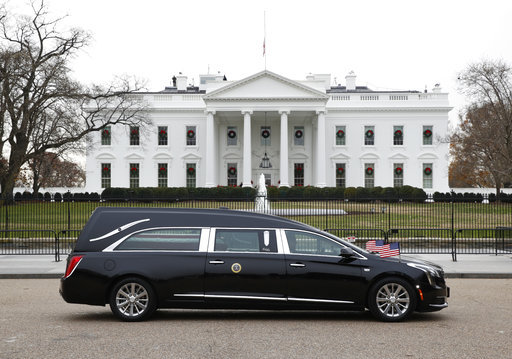 The hearse carrying the flag-draped casket of former President George H.W. Bush passes by the White House from the Capitol, heading to a State Funeral at the National Cathedral, Wednesday, Dec. 5, 2018, in Washington. [Photo: AP]