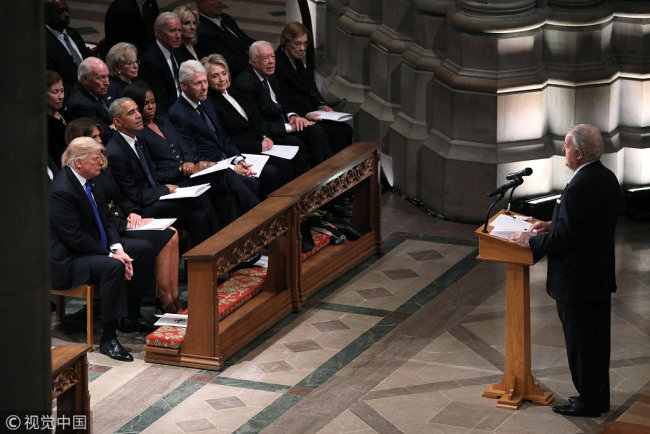 Former Canadian Prime Minister Brian Mulroney speaks as U.S. President Donald Trump and first lady Melania Trump sit with former President Barack Obama in the first row along with former first lady Michelle Obama, former President Bill Clinton and former first lady Hillary Clinton, former President Jimmy Carter and first lady Rosalynn Carter during the state funeral for former U.S. President George H.W. Bush at the Washington National Cathedral in Washington, U.S., December 5, 2018. [Photo: VCG]