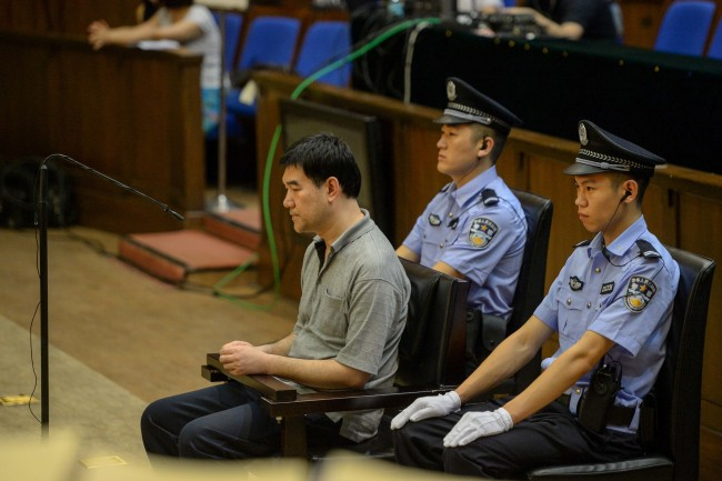 """Sun Xin, a suspect who fled abroad for seven years, was extradited back to China from Cambodia in June 2016. He plead guilty in court on July 5, 2016. He was the first red notice fugitive to be arrested and returned to China after 100 such notices were issued by Interpol following the start of China's """"Skynet"""" program.[Photo:IC]"""