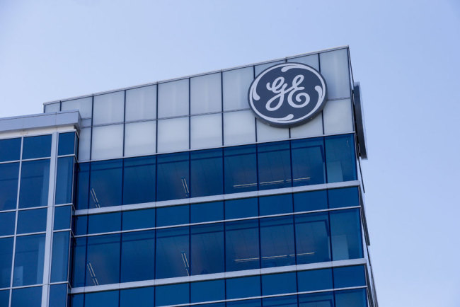 In this Jan. 16, 2018, photo, the General Electric logo is displayed at the top of their Global Operations Center in the Banks development of downtown Cincinnati. General Electric Co. reports earnings Friday, July 20.[Photo:AP]