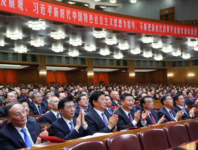 """""""Our 40 Years,"""" a grand gala in celebration of the 40th anniversary of China's reform and opening up, is held in Beijing, capital of China, Dec. 14, 2018. Xi Jinping, Li Keqiang, Li Zhanshu, Wang Yang, Wang Huning, Han Zheng and Wang Qishan were among the Communist Party of China (CPC) and state leaders who joined more than 3,000 people to watch the gala at the Great Hall of the People. [Photo: Xinhua]"""
