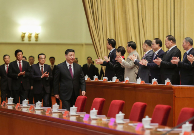 Chinese President Xi Jinping, also general secretary of the Communist Party of China (CPC) Central Committee and chairman of the Central Military Commission, attends a grand gathering to celebrate the 40th anniversary of China's reform and opening-up at the Great Hall of the People in Beijing, capital of China, Dec. 18, 2018. Xi made an important speech at the gathering. [Photo: Xinhua/Ju Peng]