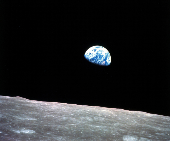 This Dec. 24, 1968, file photo made available by NASA shows the Earth behind the surface of the moon during the Apollo 8 mission. [File photo: NASA via AP/William Anders]