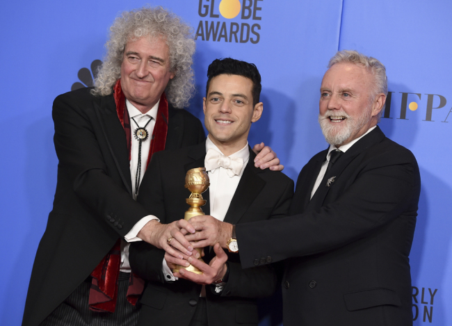 "Bohemian Brian May, left, and Roger Taylor, right, of Queen, and Rami Malek pose in the press room with the award for best motion picture, drama for ""Bohemian Rhapsody"" at the 76th annual Golden Globe Awards at the Beverly Hilton Hotel on Sunday, Jan. 6, 2019, in Beverly Hills, Calif. [Photo: Invision/AP/Jordan Strauss]"