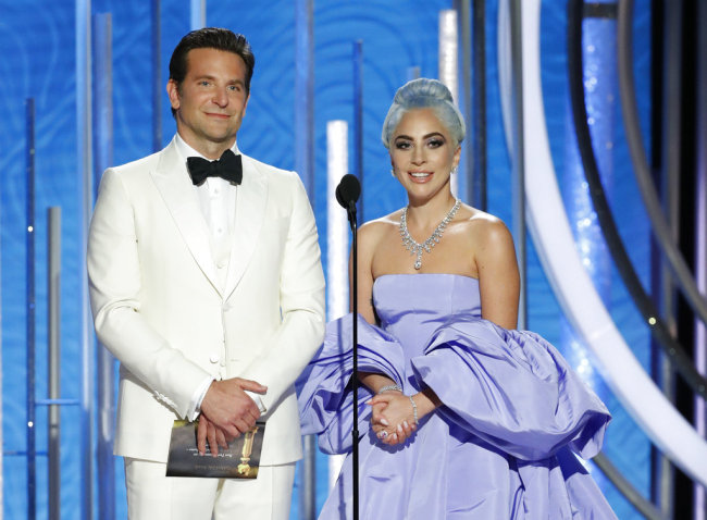 This image released by NBC shows Bradley Cooper, left, and Lady Gaga presenting the award for best actor in a TV comedy series at the 76th Annual Golden Globe Awards at the Beverly Hilton Hotel on Sunday, Jan. 6, 2019, in Beverly Hills, Calif. [Photo: NBC via AP/Paul Drinkwater]