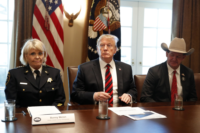 "President Donald Trump, with Carolyn ""Bunny"" Welsh, sheriff of Chester County, Pa., left, and AJ Louderback, sheriff of Jackson County, Texas, attends a roundtable discussion on border security with local leaders, Friday Jan. 11, 2019, in the Cabinet Room of the White House in Washington. [Photo: AP/Jacquelyn Martin]"