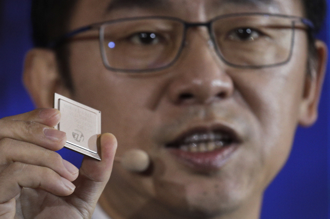 Ryan Ding, chief of Huawei's carrier business group, holds a Tiangang 5G base station chipset, speaks during a product presentation in Beijing, Thursday, Jan. 24, 2019. [Photo: AP: Andy Wong]