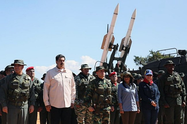 This handout photo released by the Venezuelan Presidency press office shows (L to R) Defense Minister Vladimir Padrino, President Nicolas Maduro, the Commandant of the Armed Forces Strategic Command Operations Remigio Ceballos, Vice-President Delcy Rodriguez, First Lady Cilia Flores and General Jesus Suarez Chourio, General Commander of the Bolivarian National Armed Forces, attending military exercises at Fort Guaicaipuro in Miranda state, Venezuela, on February 10, 2019. [Photo: AFP]