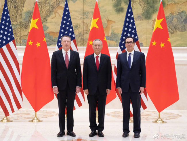 Chinese Vice Premier Liu He (center), also a member of the Political Bureau of the Communist Party of China Central Committee and chief of the Chinese side of the China-U.S. comprehensive economic dialogue, U.S. Trade Representative Robert Lighthizer (left), and Treasury Secretary Steven Mnuchin (right) participate in a new round of high-level economic and trade consultations in Beijing on Feb. 14, 2019. [Photo: Xinhua]