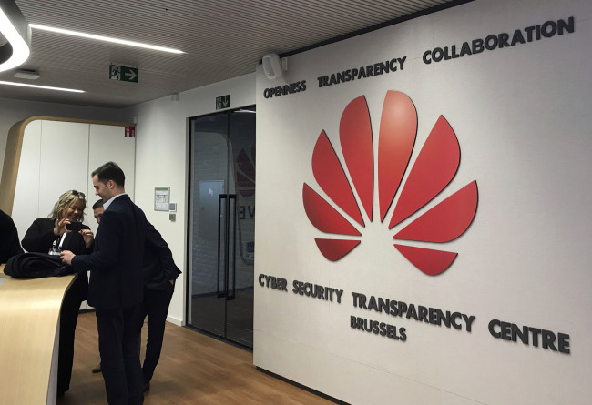 Journalists visit the new cybersecurity center of Chinese tech company Huawei, in Brussels, Tuesday March 5, 2019. Chinese tech giant Huawei is opening a cybersecurity lab in Brussels, as it tries to win over European Union leaders in a geopolitical battle with the U.S. over allegations its equipment poses a national security risk. [Photo: AP/Kelvin Chan]