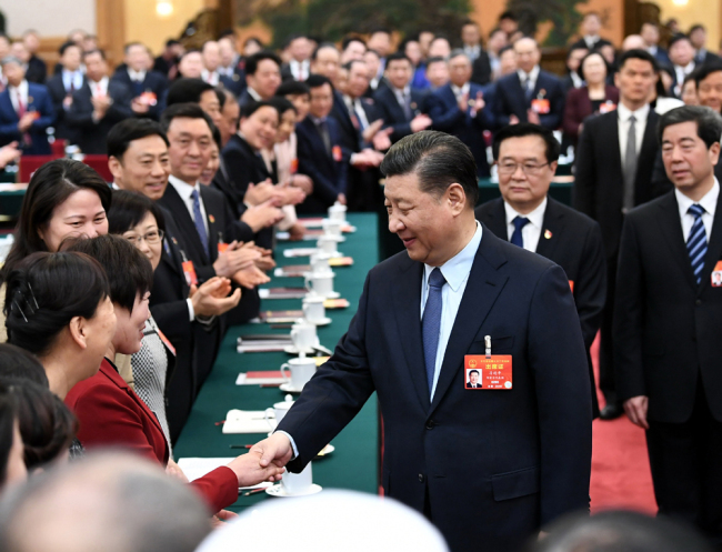 President Xi Jinping shakes hands with a deputy from Henan Province at the second session of the 13th National People''s Congress in Beijing, March 8, 2019. [Photo: Xinhua]