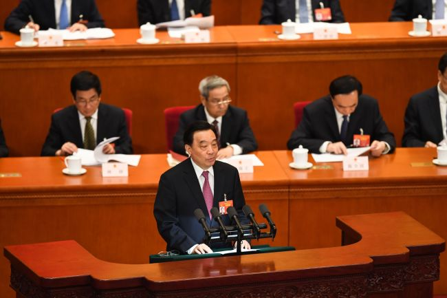 Wang Chen, vice chairman of the National People's Congress (NPC) Standing Committee, makes an explanation on the draft foreign investment law during a meeting of the NPC in Beijing, March 8, 2019. [Photo: AFP]