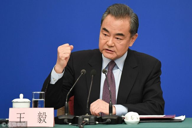 China's Foreign Minister Wang Yi answers questions during a press conference on the sidelines of the National People's Congress in Beijing on Friday, March 8, 2019. [Photo: VCG]