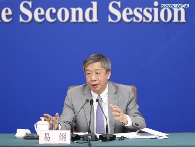Governor of the People''s Bank of China Yi Gang attends a press conference on the financial reform and development for the second session of the 13th National People''s Congress (NPC) in Beijing, capital of China, March 10, 2019. [Photo: Xinhua/Shen Bohan]