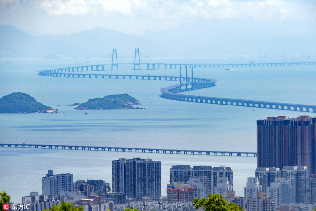 Photo taken on August 25, 2017 shows a view of the world's longest cross-sea bridge, the Hong Kong-Zhuhai-Macao Bridge, under construction against Hong Kong's Lantau Island in the background. [File Photo: IC]
