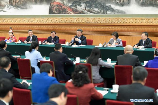 Chinese President Xi Jinping, also general secretary of the Communist Party of China Central Committee and chairman of the Central Military Commission, joins deliberation with deputies from Fujian Province at the second session of the 13th National People's Congress in Beijing, capital of China, March 10, 2019.[Photo:Xinhua]