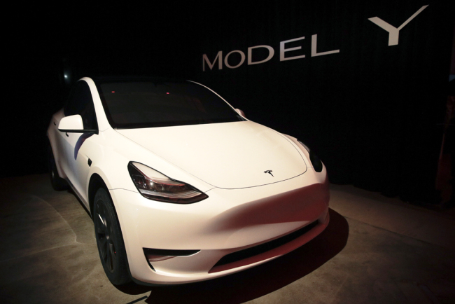 Tesla's Model Y is displayed at Tesla's design studio Thursday, March 14, 2019, in Hawthorne, Calif. The Model Y may be Tesla's most important product yet as it attempts to expand into the mainstream and generate enough cash to repay massive debts that threaten to topple the Palo Alto, California, company. [Photo: AP/Jae C. Hong]