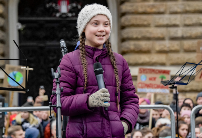 Swedish climate activist Greta Thunberg speaks on stage during a demonstration of students calling for climate protection on March 1, 2019 in front of the cityhall in Hambourg, Germany.[Photo: AFP/Axel Heimken]