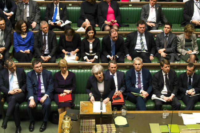 Britain's Prime Minister Theresa May speaks to lawmakers in the House of Commons, London, Wednesday March 13, 2019. In a tentative first step toward ending months of political deadlock, British lawmakers voted Wednesday to block the country from leaving the European Union without a divorce agreement, triggering an attempt to delay that departure, currently due to take place on March 29. [Photo: AP]