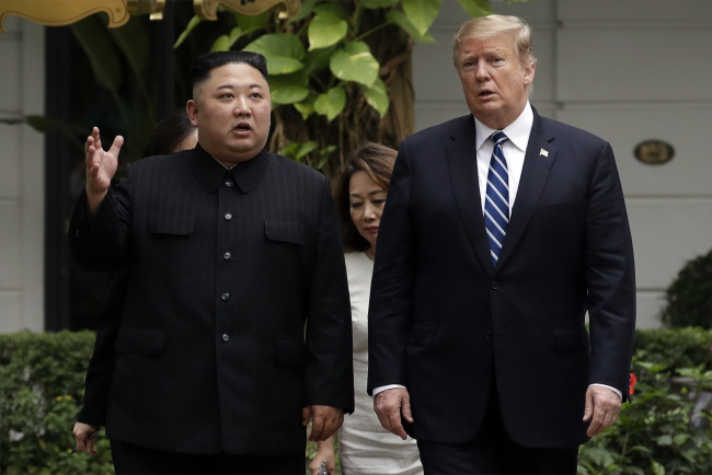 President Donald Trump and North Korean leader Kim Jong Un take a walk after their first meeting at the Sofitel Legend Metropole Hanoi hotel, Thursday, Feb. 28, 2019, in Hanoi. [Photo: AP/Evan Vucci]