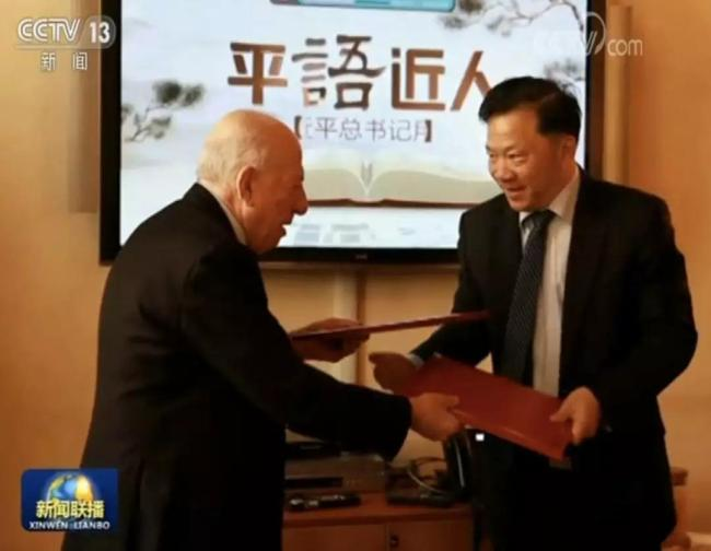Shen Haixiong, President of China Media Group, and Fedele Confalonieri, Chairman of Mediaset, sign a memorandum of understanding in Rome on March 21, 2019. [Photo: China Plus]