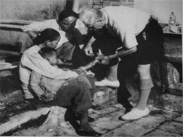 The file photo shows Jean-Augustin Bussière was treating a patient in China.[Photo:China Plus]